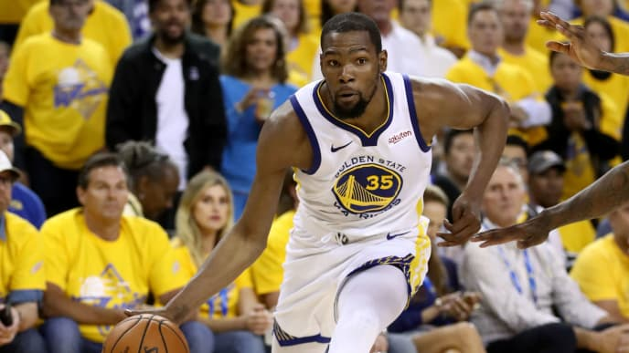 OAKLAND, CALIFORNIA - MAY 08:   Kevin Durant #35 of the Golden State Warriors in action against the Houston Rockets during Game Five of the Western Conference Semifinals of the 2019 NBA Playoffs at ORACLE Arena on May 08, 2019 in Oakland, California.  NOTE TO USER: User expressly acknowledges and agrees that, by downloading and or using this photograph, User is consenting to the terms and conditions of the Getty Images License Agreement.  (Photo by Ezra Shaw/Getty Images)