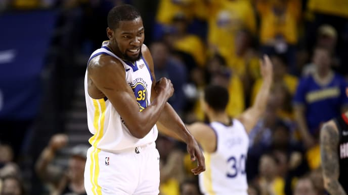 OAKLAND, CALIFORNIA - MAY 08:   Kevin Durant #35 of the Golden State Warriors reacts after the Warriors scored a basket against the Houston Rockets during Game Five of the Western Conference Semifinals of the 2019 NBA Playoffs at ORACLE Arena on May 08, 2019 in Oakland, California.  NOTE TO USER: User expressly acknowledges and agrees that, by downloading and or using this photograph, User is consenting to the terms and conditions of the Getty Images License Agreement.  (Photo by Ezra Shaw/Getty Images)