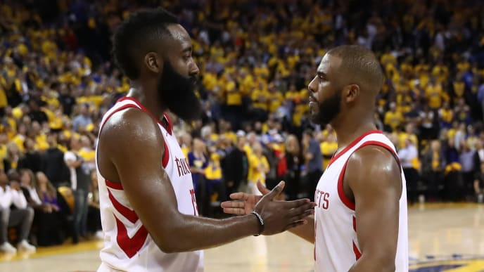 OAKLAND, CA - MAY 22:  James Harden #13 and Chris Paul #3 of the Houston Rockets stand on the court as the officials review a play at the end of Game Four of the Western Conference Finals of the 2018 NBA Playoffs at ORACLE Arena on May 22, 2018 in Oakland, California. NOTE TO USER: User expressly acknowledges and agrees that, by downloading and or using this photograph, User is consenting to the terms and conditions of the Getty Images License Agreement.  (Photo by Ezra Shaw/Getty Images)