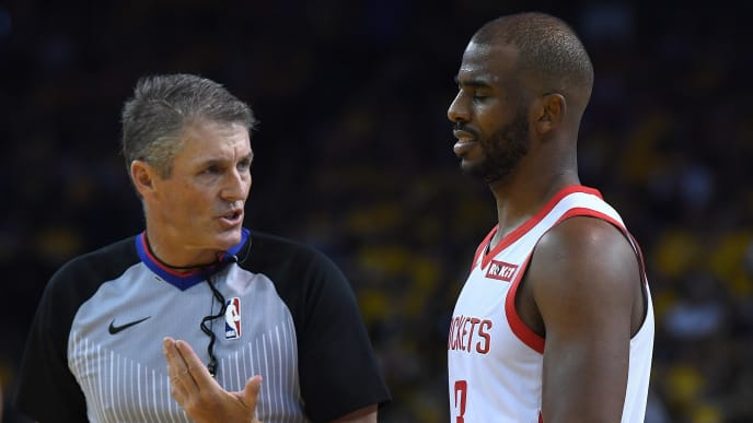 OAKLAND, CA - APRIL 30:  Referee Scott Foster #48 talks over a foul call made on Chris Paul #3 of the Houston Rockets against the Golden State Warriors in Game Two of the Second Round of the 2019 NBA Western Conference Playoffs at ORACLE Arena on April 30, 2019 in Oakland, California. NOTE TO USER: User expressly acknowledges and agrees that, by downloading and or using this photograph, User is consenting to the terms and conditions of the Getty Images License Agreement.  (Photo by Thearon W. Henderson/Getty Images)