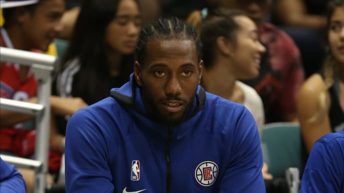 HONOLULU, HI - OCTOBER 03:Kawhi Leonard #2 of the Los Angeles Clippers watches from the sideline during the fourth quarter of the game against the Houston Rockets at the Stan Sheriff Center on October 3, 2019 in Honolulu, Hawaii. TO USER: User expressly acknowledges and agrees that, by downloading and/or using this photograph, user is consenting to the terms and conditions of the Getty Images License Agreement. (Photo by Darryl Oumi/Getty Images)