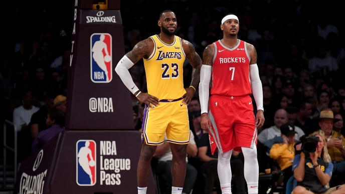 LOS ANGELES, CA - OCTOBER 20:  LeBron James #23 of the Los Angeles Lakers and Carmelo Anthony #7 of the Houston Rockets wait for and inbound at Staples Center on October 20, 2018 in Los Angeles, California.  (Photo by Harry How/Getty Images)