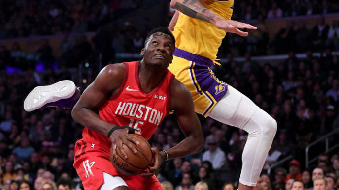 LOS ANGELES, CALIFORNIA - FEBRUARY 21:  Clint Capela #15 of the Houston Rockets fakes JaVale McGee #7 of the Los Angeles Lakers creating a foul during the first half at Staples Center on February 21, 2019 in Los Angeles, California. (Photo by Harry How/Getty Images)