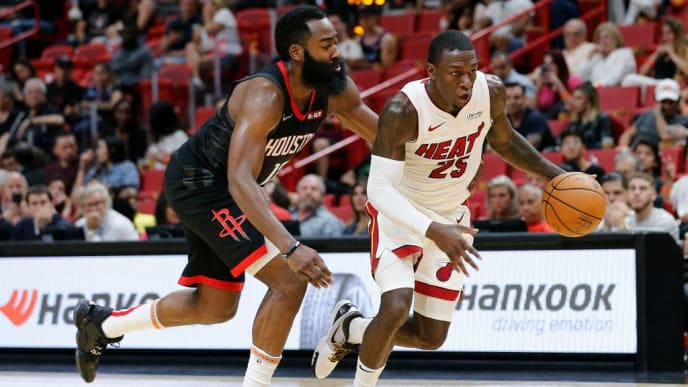 MIAMI, FLORIDA - OCTOBER 18:  Kendrick Nunn #25 of the Miami Heat drives to the basket against James Harden #13 of the Houston Rockets during the second half at American Airlines Arena on October 18, 2019 in Miami, Florida. NOTE TO USER: User expressly acknowledges and agrees that, by downloading and or using this photograph, User is consenting to the terms and conditions of the Getty Images License Agreement. (Photo by Michael Reaves/Getty Images)
