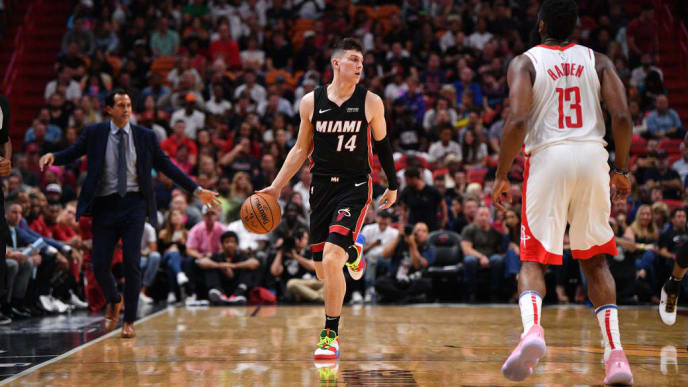 MIAMI, FLORIDA - NOVEMBER 03: Tyler Herro #14 of the Miami Heat dribbles the ball against the James Harden #13 of the Houston Rockets in the second half at American Airlines Arena on November 03, 2019 in Miami, Florida. NOTE TO USER: User expressly acknowledges and agrees that, by downloading and or using this photograph, User is consenting to the terms and conditions of the Getty Images License Agreement. (Photo by Mark Brown/Getty Images)