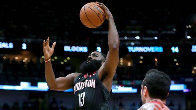 NEW ORLEANS, LOUISIANA - NOVEMBER 11: James Harden #13 of the Houston Rockets shoots over Jrue Holiday #11 of the New Orleans Pelicans during a NBA game at the Smoothie King Center on November 11, 2019 in New Orleans, Louisiana. NOTE TO USER: User expressly acknowledges and agrees that, by downloading and or using this photograph, User is consenting to the terms and conditions of the Getty Images License Agreement. (Photo by Sean Gardner/Getty Images)