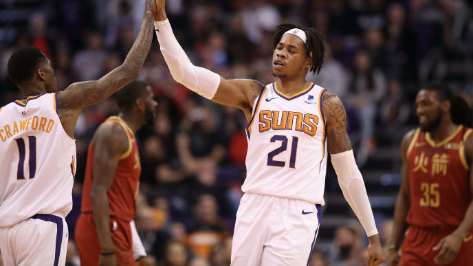 PHOENIX, ARIZONA - FEBRUARY 04:  Richaun Holmes #21 of the Phoenix Suns high fives Jamal Crawford #11 of the Phoenix Suns during the first half of the NBA game against the Houston Rockets at Talking Stick Resort Arena on February 04, 2019 in Phoenix, Arizona. (Photo by Christian Petersen/Getty Images)