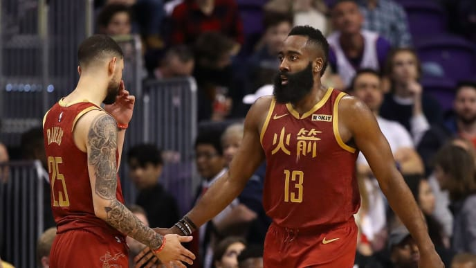 PHOENIX, ARIZONA - FEBRUARY 04:  James Harden #13 of the Houston Rockets high fives Austin Rivers #25 after scoring against the Phoenix Suns during the second half of the NBA game at Talking Stick Resort Arena on February 04, 2019 in Phoenix, Arizona. The Rockets defeated the Suns 118-110. (Photo by Christian Petersen/Getty Images)