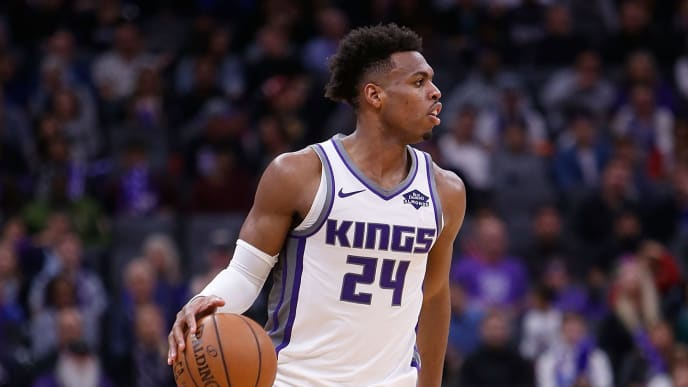 SACRAMENTO, CA - APRIL 02: Buddy Hield #24 of the Sacramento Kings dribbles the ball up court against the Houston Rockets at Golden 1 Center on April 2, 2019 in Sacramento, California. NOTE TO USER: User expressly acknowledges and agrees that, by downloading and or using this photograph, User is consenting to the terms and conditions of the Getty Images License Agreement. (Photo by Lachlan Cunningham/Getty Images)