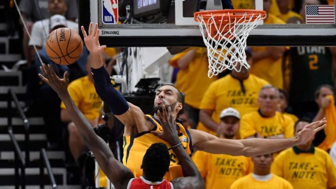 SALT LAKE CITY, UT - MAY 06 Rudy Gobert #27 of the Utah Jazz blocks the shot of Clint Capela #15 of the Houston Rockets in the first half during Game Four of Round Two of the 2018 NBA Playoffs at Vivint Smart Home Arena on May 6, 2018 in Salt Lake City, Utah. NOTE TO USER: User expressly acknowledges and agrees that, by downloading and or using this photograph, User is consenting to the terms and conditions of the Getty Images License Agreement. (Photo by Gene Sweeney Jr./Getty Images)