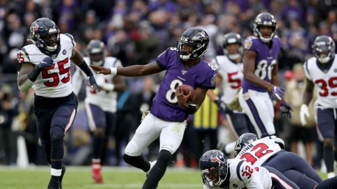 BALTIMORE, MARYLAND - NOVEMBER 17: Lamar Jackson #8 of the Baltimore Ravens rushes for a first down in the third quarter against the Houston Texans at M&T Bank Stadium on November 17, 2019 in Baltimore, Maryland. (Photo by Rob Carr/Getty Images)