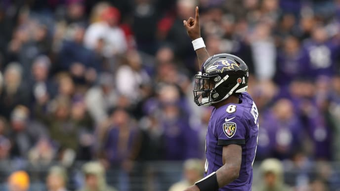 BALTIMORE, MARYLAND - NOVEMBER 17: Quarterback Lamar Jackson #8 of the Baltimore Ravens celebrates a touchdown pass to running back Mark Ingram #21 of the Baltimore Ravens (not pictured) against the Houston Texans during the third quarter during the third quarter at M&T Bank Stadium on November 17, 2019 in Baltimore, Maryland. (Photo by Patrick Smith/Getty Images)