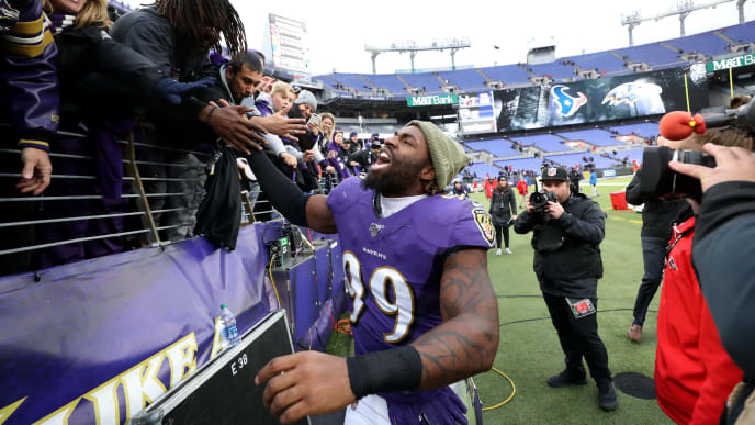 BALTIMORE, MARYLAND - NOVEMBER 17: Matt Judon #99 of the Baltimore Ravens celebrates with fans following the Ravens win over the Houston Texans at M&T Bank Stadium on November 17, 2019 in Baltimore, Maryland. (Photo by Rob Carr/Getty Images)