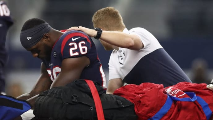 ARLINGTON, TEXAS - AUGUST 24:  Lamar Miller #26 of the Houston Texans leaves the game after an injury in the first quarter during a NFL preseason game against the Dallas Cowboys at AT&T Stadium on August 24, 2019 in Arlington, Texas. (Photo by Ronald Martinez/Getty Images)