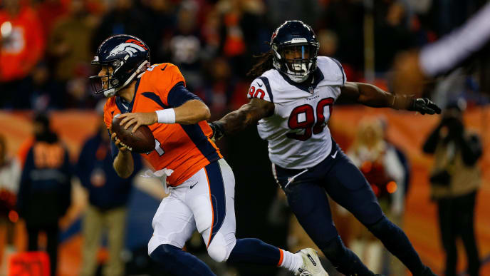 DENVER, CO - NOVEMBER 4:  Quarterback Case Keenum #4 of the Denver Broncos looks to escape a tackle attempt by outside linebacker Jadeveon Clowney #90 of the Houston Texans at Broncos Stadium at Mile High on November 4, 2018 in Denver, Colorado. (Photo by Justin Edmonds/Getty Images)
