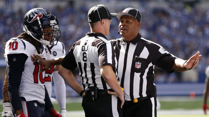 INDIANAPOLIS, INDIANA - OCTOBER 20: DeAndre Hopkins #10 of the Houston Texans talks line judge Dana McKenzie #8 and side judge Boris Cheek after a play during the second quarter during the game against the Indianapolis Colts at Lucas Oil Stadium on October 20, 2019 in Indianapolis, Indiana. (Photo by Justin Casterline/Getty Images)