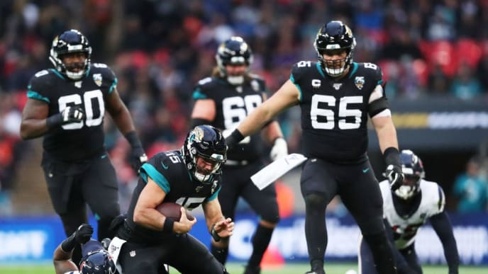 LONDON, ENGLAND - NOVEMBER 03: Gardner Minshew #15 of the Jacksonville Jaguars is tackled by Zach Cunningham #41 of the Houston Texans during the NFL match between the Houston Texans andJacksonville Jaguars at Wembley Stadium on November 03, 2019 in London, England. (Photo by Jack Thomas/Getty Images)
