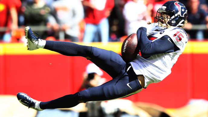 KANSAS CITY, MISSOURI - OCTOBER 13: Will Fuller #15 of the Houston Texans attempts to make a reception during the first half against the Kansas City Chiefs at Arrowhead Stadium on October 13, 2019 in Kansas City, Missouri. (Photo by Jamie Squire/Getty Images)