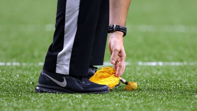 NEW ORLEANS, LOUISIANA - SEPTEMBER 09: An official picks up a penalty flag during a game between the New Orleans Saints and the Houston Texans at the Mercedes Benz Superdome on September 09, 2019 in New Orleans, Louisiana. (Photo by Jonathan Bachman/Getty Images)