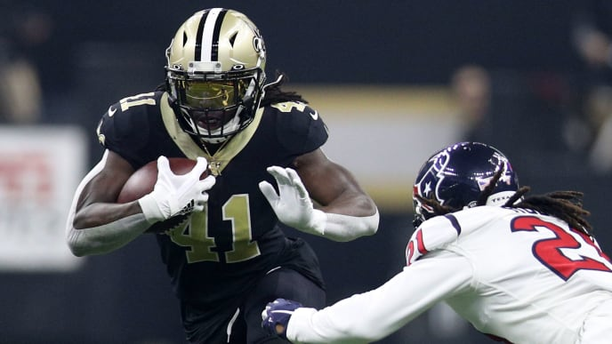 NEW ORLEANS, LOUISIANA - SEPTEMBER 09: Alvin Kamara #41 of the New Orleans Saints avoids a tackle by Bradley Roby #21 of the Houston Texans  at Mercedes Benz Superdome on September 09, 2019 in New Orleans, Louisiana. (Photo by Chris Graythen/Getty Images)