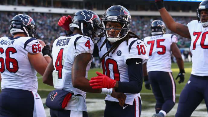 PHILADELPHIA, PA - DECEMBER 23:  Quarterback Deshaun Watson #4 of the Houston Texans celebrates his touchdown with teammate wide receiver DeAndre Hopkins #10 against the Philadelphia Eagles during the second quarter at Lincoln Financial Field on December 23, 2018 in Philadelphia, Pennsylvania.  (Photo by Mitchell Leff/Getty Images)