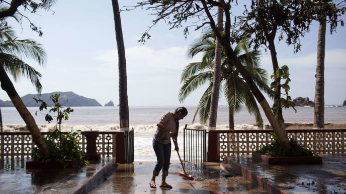 MELAQUE, MEXICO - OCTOBER 24: A worker cleans out the 'Monterey' Hotel after damage from Hurricane Patricia October 24, 2015 in Melaque, Jalisco, Mexico. Hurricane Patricia struck Mexico's West coast as the most powerful storm ever recorded in the Western Hemisphere but rapidly lost energy as it moved inland.  (Photo by Brett Gundlock/Getty Images)