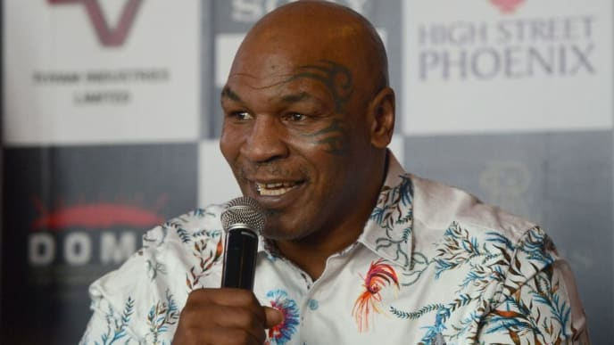 Former US boxer Mike Tyson speaks during a news conference to announce India's first global mixed martial arts Kumite 1 league in Mumbai on September 28, 2018. (Photo by PUNIT PARANJPE / AFP)        (Photo credit should read PUNIT PARANJPE/AFP/Getty Images)