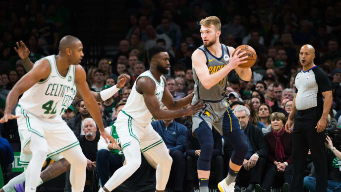 BOSTON, MA - MARCH 29: Domantas Sabonis #11 of the Indiana Pacers is defended by Jaylen Brown #7 of the Boston Celtics at TD Garden on March 29, 2019 in Boston, Massachusetts. NOTE TO USER: User expressly acknowledges and agrees that, by downloading and or using this photograph, User is consenting to the terms and conditions of the Getty Images License Agreement. (Photo by Kathryn Riley/Getty Images)