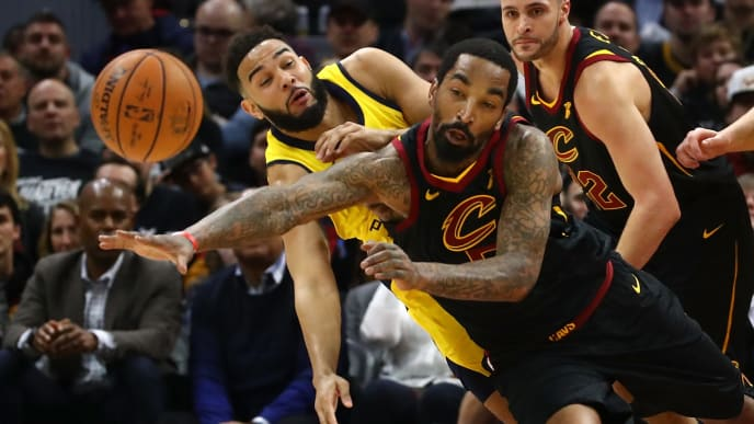 CLEVELAND, OH - APRIL 15:  JR Smith #5 of the Cleveland Cavaliers and Cory Joseph #6 of the Indiana Pacers drive for a ball during the first half in Game One of the Eastern Conference Quarterfinals during the 2018 NBA Playoffs at Quicken Loans Arena on April 15, 2018 in Cleveland, Ohio. NOTE TO USER: User expressly acknowledges and agrees that, by downloading and or using this photograph, User is consenting to the terms and conditions of the Getty Images License Agreement. (Photo by Gregory Shamus/Getty Images)