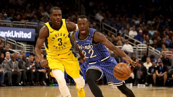ORLANDO, FLORIDA - DECEMBER 07: Jerian Grant #22 of the Orlando Magic drives against Aaron Holiday #3 of the Indiana Pacers during the game at Amway Center on December 07, 2018 in Orlando, Florida.  NOTE TO USER: User expressly acknowledges and agrees that, by downloading and or using this photograph, User is consenting to the terms and conditions of the Getty Images License Agreement. (Photo by Sam Greenwood/Getty Images)
