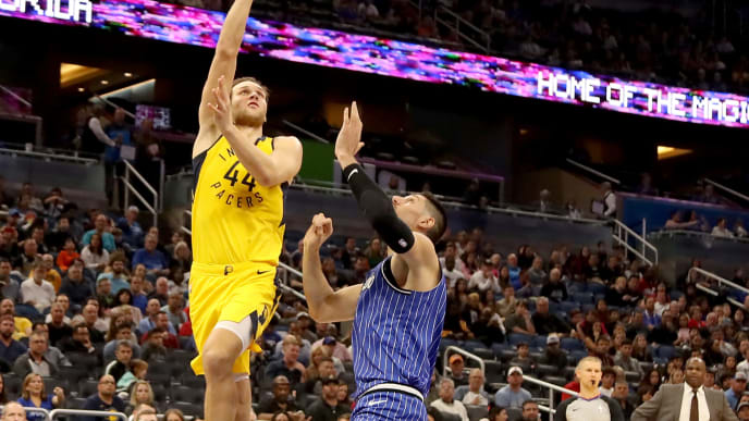 ORLANDO, FLORIDA - DECEMBER 07: Bojan Bogdanovic #44 of the Indiana Pacers attempts a shot over Nikola Vucevic #9 of the Orlando Magic during the game at Amway Center on December 07, 2018 in Orlando, Florida.  NOTE TO USER: User expressly acknowledges and agrees that, by downloading and or using this photograph, User is consenting to the terms and conditions of the Getty Images License Agreement. (Photo by Sam Greenwood/Getty Images)