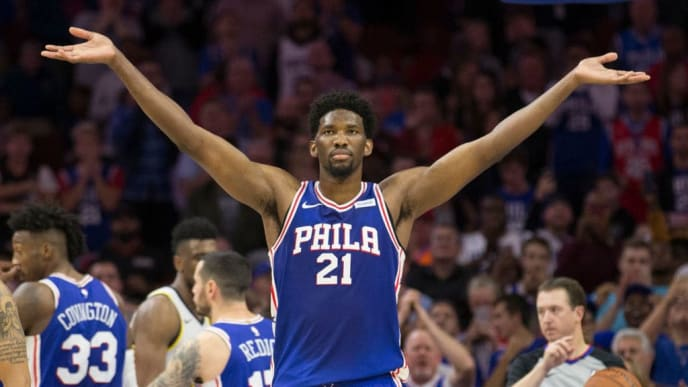 PHILADELPHIA, PA - NOVEMBER 3: Joel Embiid #21 of the Philadelphia 76ers reacts after a made foul shot in the fourth quarter against the Indiana Pacers at the Wells Fargo Center on November 3, 2017 in Philadelphia, Pennsylvania. The 76ers defeated the Pacers 121-110. NOTE TO USER: User expressly acknowledges and agrees that, by downloading and or using this photograph, User is consenting to the terms and conditions of the Getty Images License Agreement. (Photo by Mitchell Leff/Getty Images)