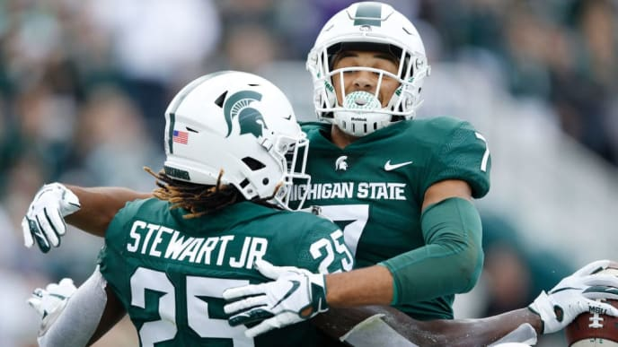 EAST LANSING, MI - SEPTEMBER 28: Darrell Stewart Jr. #25 of the Michigan State Spartans celebrates with Cody White #7 after catching a pass for a five-yard touchdown in the second quarter against the Indiana Hoosiers at Spartan Stadium on September 28, 2019 in East Lansing, Michigan. (Photo by Joe Robbins/Getty Images)