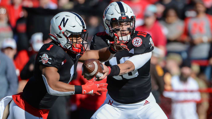 LINCOLN, NE - OCTOBER 26: Quarterback Noah Vedral #16 of the Nebraska Cornhuskers hands off to wide receiver Wan'Dale Robinson #1 against the Indiana Hoosiers at Memorial Stadium on October 26, 2019 in Lincoln, Nebraska. (Photo by Steven Branscombe/Getty Images)