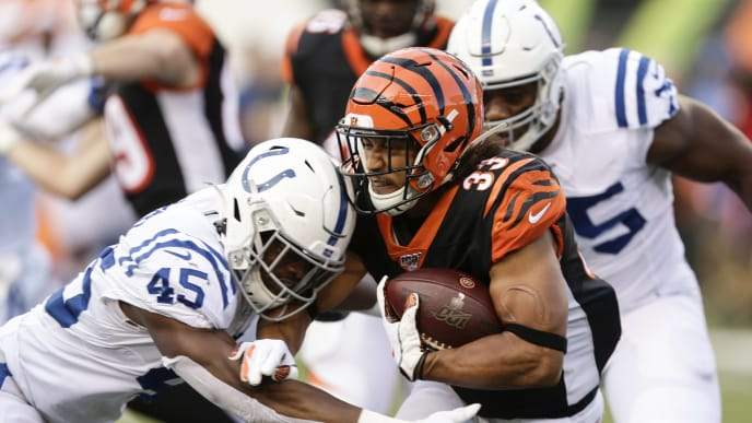 CINCINNATI, OHIO - AUGUST 29: Rodney Anderson #33 of the Cincinnati Bengals is tackled while running with the ball by E.J. Speed #45 of the Indianapolis Colts during the first quarter of a preseason game at Paul Brown Stadium on August 29, 2019 in Cincinnati, Ohio. (Photo by Silas Walker/Getty Images) (Photo by Silas Walker/Getty Images)
