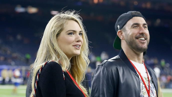 HOUSTON, TEXAS - NOVEMBER 21:  Supermodel Kate Upton and husband, Houston Astros pitcher, Justin Verlander walk on to the field before the game between the Houston Texans and the Indianapolis Colts at NRG Stadium on November 21, 2019 in Houston, Texas. (Photo by Bob Levey/Getty Images)
