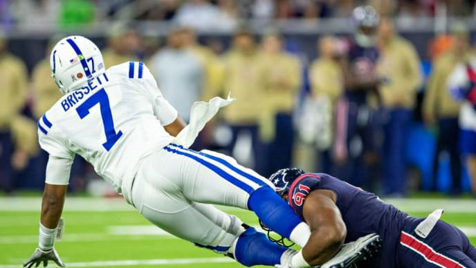 HOUSTON, TX - NOVEMBER 21:  Jacoby Brissett #7 of the Indianapolis Colts is tackled from behind by Carlos Watkins #91 of the Houston Texans at NRG Stadium on November 21, 2019 in Houston, Texas.  The Texans defeated the Colts 20-17. (Photo by Wesley Hitt/Getty Images)