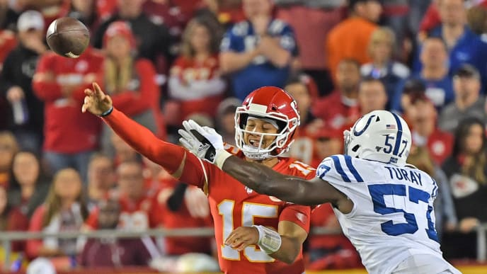 KANSAS CITY, MO - OCTOBER 06:  Quarterback Patrick Mahomes #15 of the Kansas City Chiefs throws a pass under pressure from defensive end Kemoko Turay #57 of the Indianapolis Colts against during the first half at Arrowhead Stadium on October 6, 2019 in Kansas City, Missouri. (Photo by Peter Aiken/Getty Images)