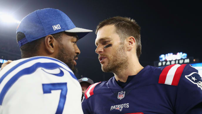 FOXBOROUGH, MA - OCTOBER 04:  Tom Brady #12 of the New England Patriots shakes hands with Jacoby Brissett #7 of the Indianapolis Colts after the Patriots defeated the Colts 38-24 at Gillette Stadium on October 4, 2018 in Foxborough, Massachusetts.  (Photo by Adam Glanzman/Getty Images)
