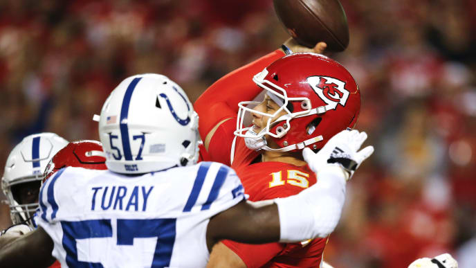 KANSAS CITY, MO - OCTOBER 06: Patrick Mahomes #15 of the Kansas City Chiefs releases the football before being hit by Kemoko Turay #57 of the Indianapolis Colts in the third quarter at Arrowhead Stadium on October 6, 2019 in Kansas City, Missouri. Mahomes limped off the field following the play. (Photo by David Eulitt/Getty Images)
