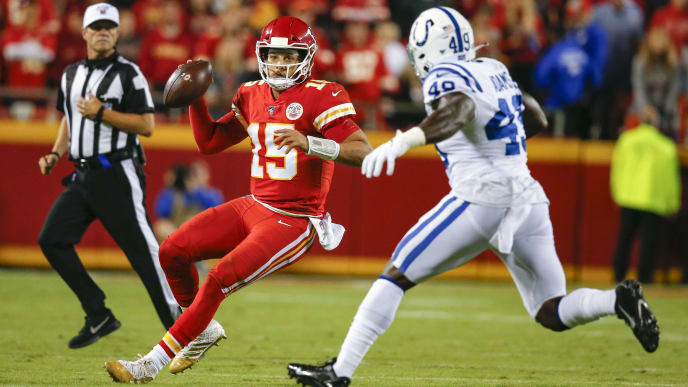 KANSAS CITY, MO - OCTOBER 06: Patrick Mahomes #15 of the Kansas City Chiefs scrambles to elude Matthew Adams #49 of the Indianapolis Colts in the second quarter at Arrowhead Stadium on October 6, 2019 in Kansas City, Missouri. (Photo by David Eulitt/Getty Images)