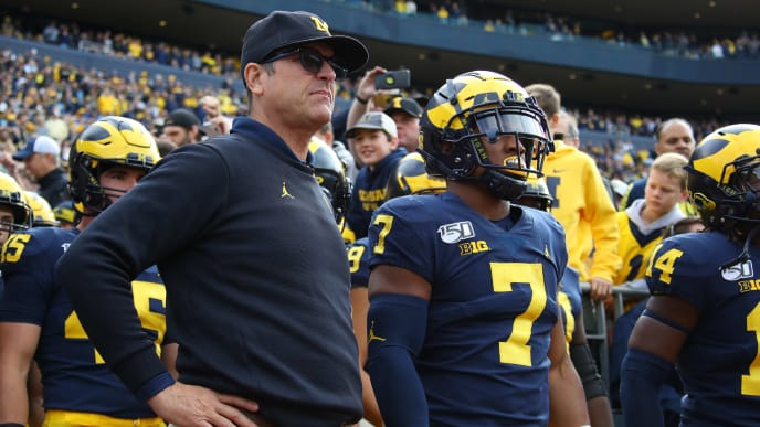 ANN ARBOR, MICHIGAN - OCTOBER 05:  Head coach Jim Harbaugh waits to take the field to play the Iowa Hawkeyes at Michigan Stadium on October 05, 2019 in Ann Arbor, Michigan. Michigan won the game 10-3. (Photo by Gregory Shamus/Getty Images)