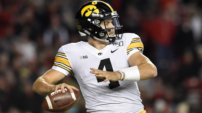 MADISON, WISCONSIN - NOVEMBER 09: Nate Stanley #4 of the Iowa Hawkeyes passes the football in the second half against the Wisconsin Badgers at Camp Randall Stadium on November 09, 2019 in Madison, Wisconsin. (Photo by Quinn Harris/Getty Images)