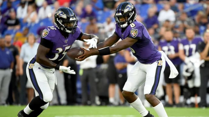BALTIMORE, MD - AUGUST 08: Lamar Jackson #8 of the Baltimore Ravens hands the ball off to Gus Edwards #35 during the first half of a preseason game against the Jacksonville Jaguars at M&T Bank Stadium on August 8, 2019 in Baltimore, Maryland. (Photo by Will Newton/Getty Images)