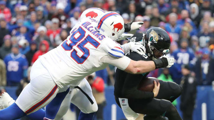 BUFFALO, NY - NOVEMBER 25: Blake Bortles #5 of the Jacksonville Jaguars is sacked by Kyle Williams #95 of the Buffalo Bills and Jerry Hughes #55 in the third quarter during NFL game action at New Era Field on November 25, 2018 in Buffalo, New York. (Photo by Tom Szczerbowski/Getty Images)
