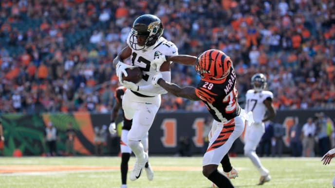 CINCINNATI, OHIO - OCTOBER 20:   Dede Westbrook #12 of the Jacksonville Jaguars catches a pass while defended by Tony McRae #29 of the Cincinnati Bengals at Paul Brown Stadium on October 20, 2019 in Cincinnati, Ohio. (Photo by Andy Lyons/Getty Images)