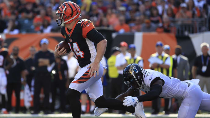 CINCINNATI, OHIO - OCTOBER 20:   Andy Dalton #14 of the Cincinnati Bengals runs with the ball during the game against the Jacksonville Jaguars at Paul Brown Stadium on October 20, 2019 in Cincinnati, Ohio. (Photo by Andy Lyons/Getty Images)