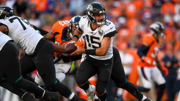 DENVER, CO - SEPTEMBER 29:  Gardner Minshew #15 of the Jacksonville Jaguars turns to hand off against the Denver Broncos in the fourth quarter of a game at Empower Field at Mile High on September 29, 2019 in Denver, Colorado. (Photo by Dustin Bradford/Getty Images)