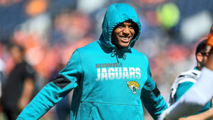 DENVER, CO - SEPTEMBER 29:  Jalen Ramsey #20 of the Jacksonville Jaguars stands on the field in street clothes as players warm up before a game against the Denver Broncos at Empower Field at Mile High on September 29, 2019 in Denver, Colorado. (Photo by Dustin Bradford/Getty Images)