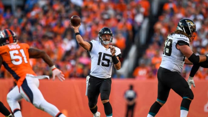 DENVER, CO - SEPTEMBER 29:  Gardner Minshew #15 of the Jacksonville Jaguars passes against the Denver Broncos in the fourth quarter of a game at Empower Field at Mile High on September 29, 2019 in Denver, Colorado. (Photo by Dustin Bradford/Getty Images)